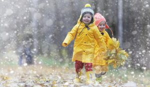 Children laughing and playing in the rain