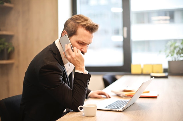 Man looking unhappy on phone call